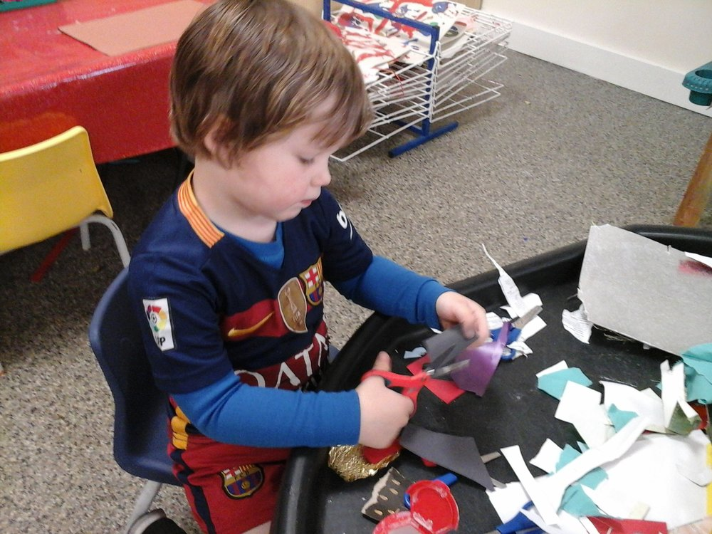 Austin spent a long time cutting at the cutting station. The children love cutting up different materials.