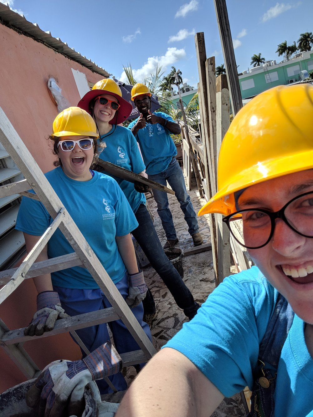 Taylor Vaughan, Sarah Jones, AJ Stanley, and Becca Mercer from Team 2 are shown smiling together before their day's work was started. They spent most of the day doing rebar. Not pictured is Korie Burgess, who spent most of her day tearing out tile from the bathroom.