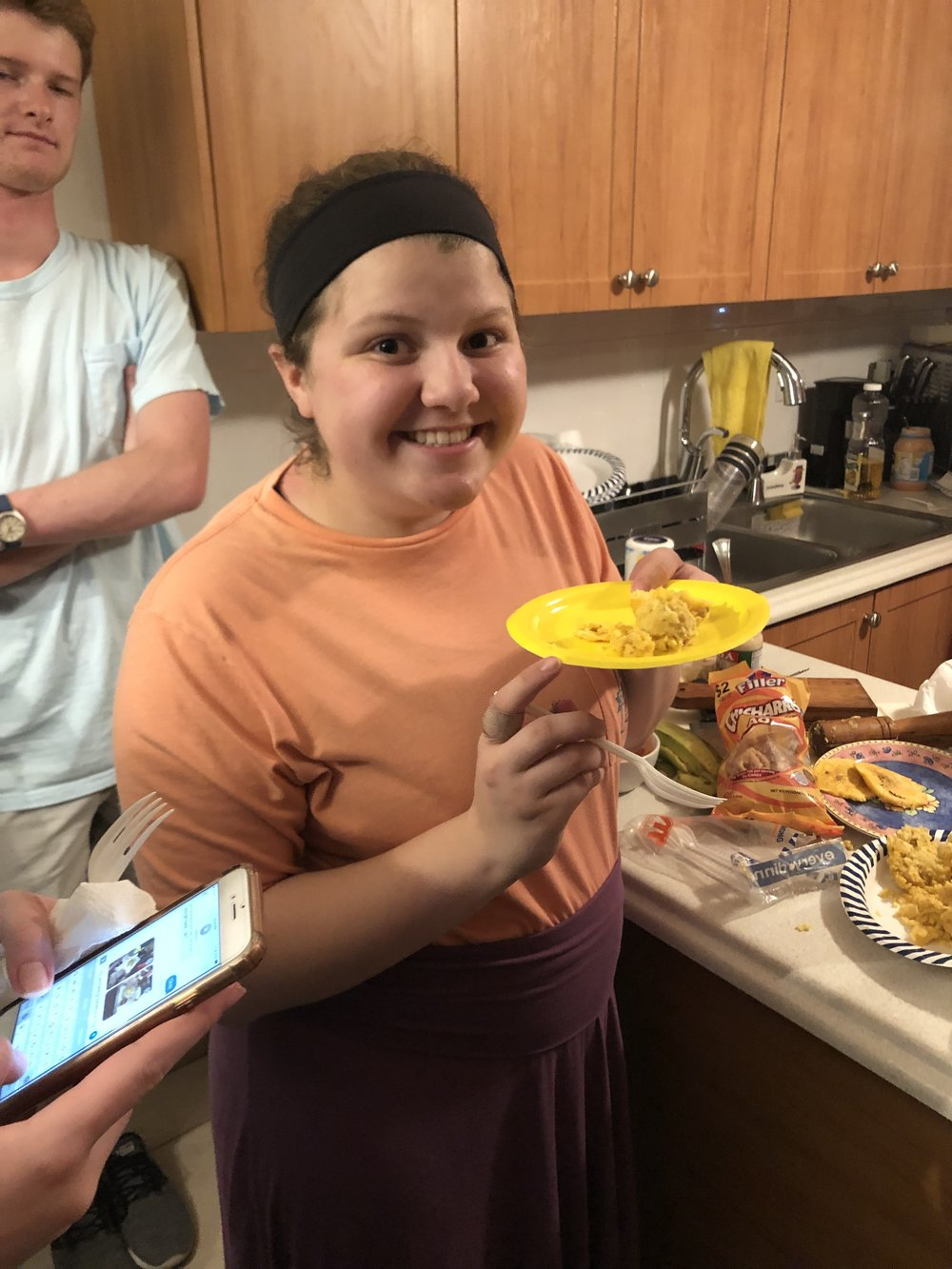 Taylor Vaughan hands out the Tostones that Ivonne generously made for the entire group