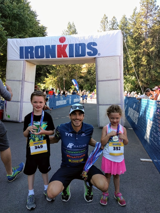 The kids with pro triathlete  Andy Potts  after their fun run.