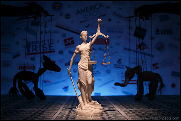 "The awareness that we are all human beings together has become lost in war and through politics. -Albert Schweitzer   (photo  Democracy  by Robin Ay - RAconcepts.com) Blinded Lady Justice holds her scales high atop a ""field of money"" as the  Democrat Donkey and Republican Elephan t, portrayed as puppets, stand off in front of a Super Pac logo nightmare. A true take on the US political system."