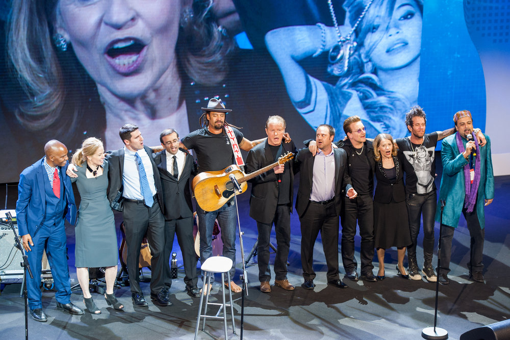 Skoll awardees with Michael Franti, Don Henley, Jeff Skoll, Sally Osberg and Bono at SWF 2017.
