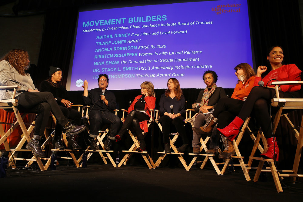 (L-R) Abigail Disney, Tilane Jones, Angela Robinson, Pat Mitchell, Kirsten Schaffer, Nina Shaw, Dr. Stacy L. Smith, and Tessa Thompson speak onstage at The Sundance Institute, Refinery29 and DOVE Chocolate Present 2018 Women at Sundance Brunch on January 22, 2018 in Park City, Utah. (Photo by Phillip Faraone/Getty Images for Refinery29)