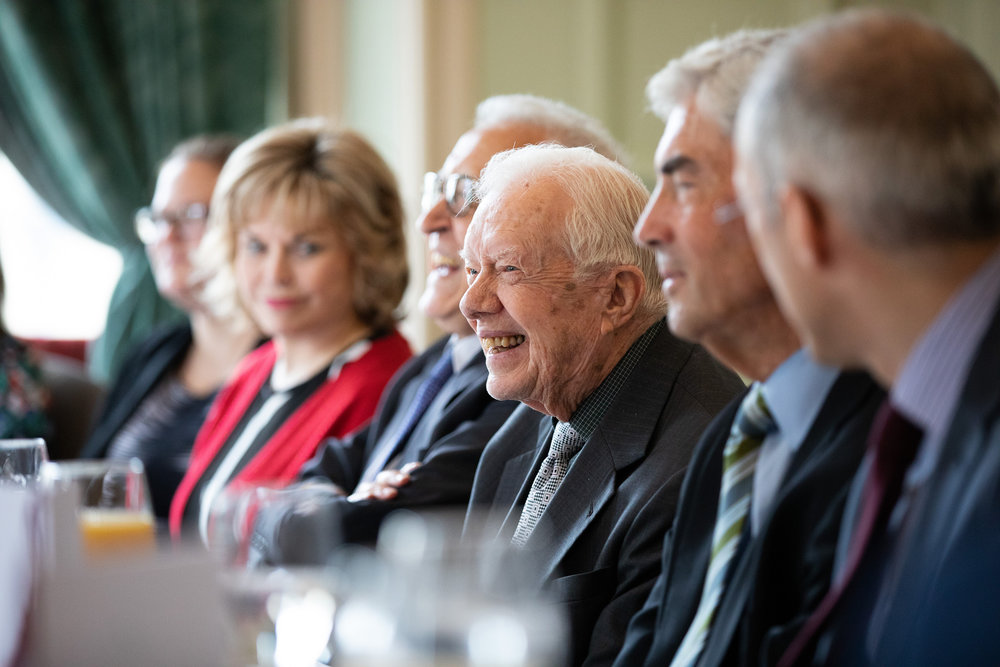 Dinner at the Randolph Hotel with President Jimmy Carter in foreground.