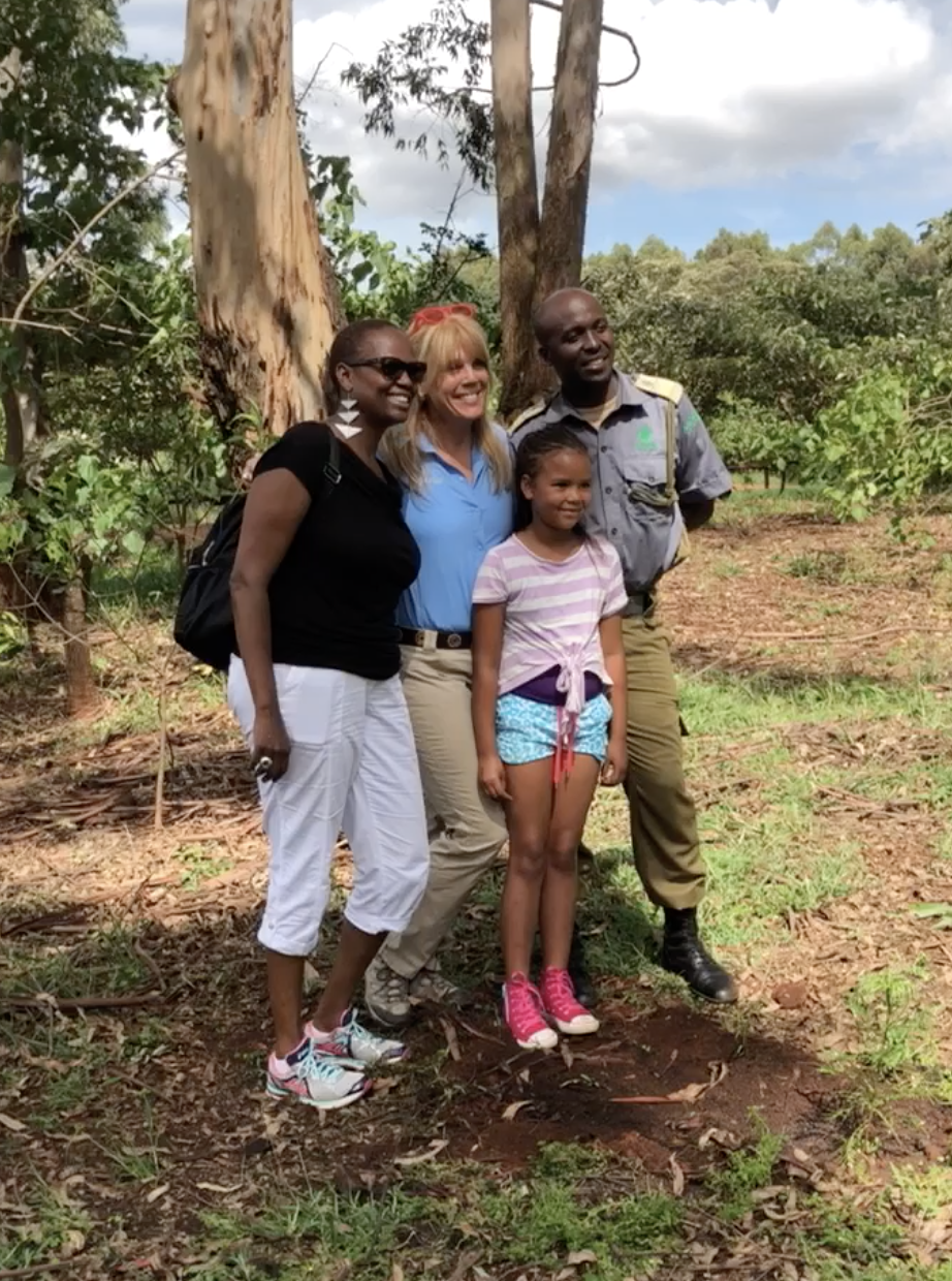 Wanjira Mathaai, daughter of Nobel Peace Prize Wangari Mathaai, her daughter and husband with Laura Turner Seydel in the People's Park where her mother planted one million trees. We added a few!