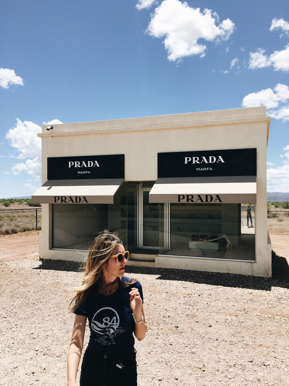 Stopping at Prada Marfa in Valentine, Texas. The product in the Art exhibit is from Prada's 2005 collection. It's been sitting enjoying the company of hundreds of moths and dust balls for quite some time.