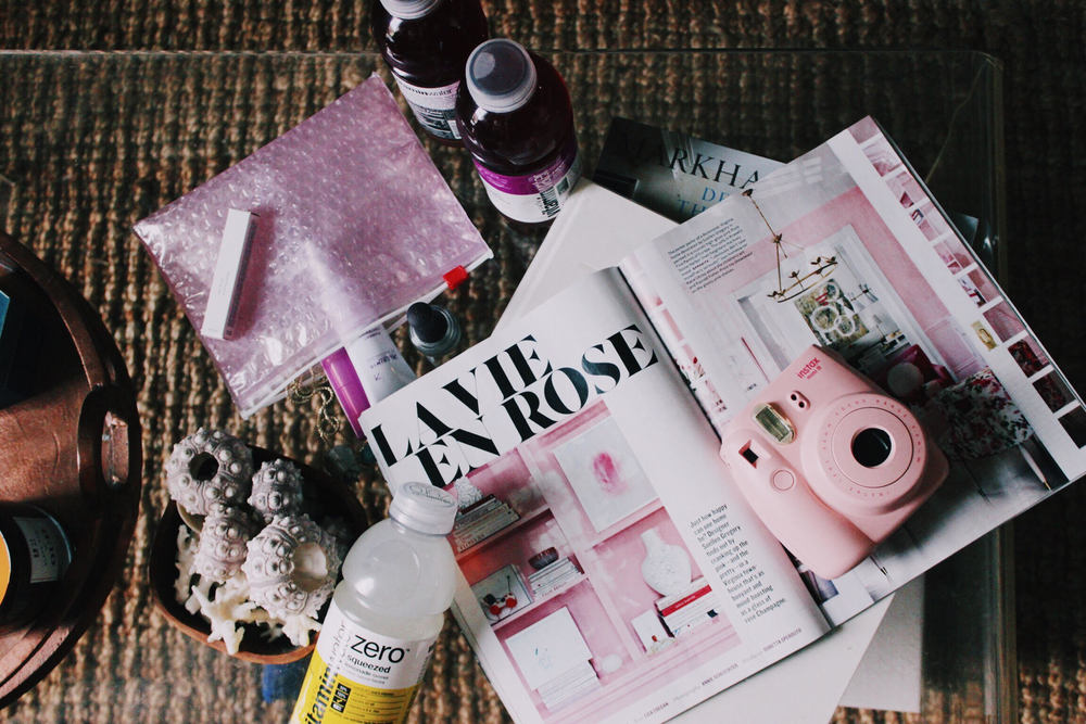 Summer at home: favorite magazines. beauty products and vitamin water
