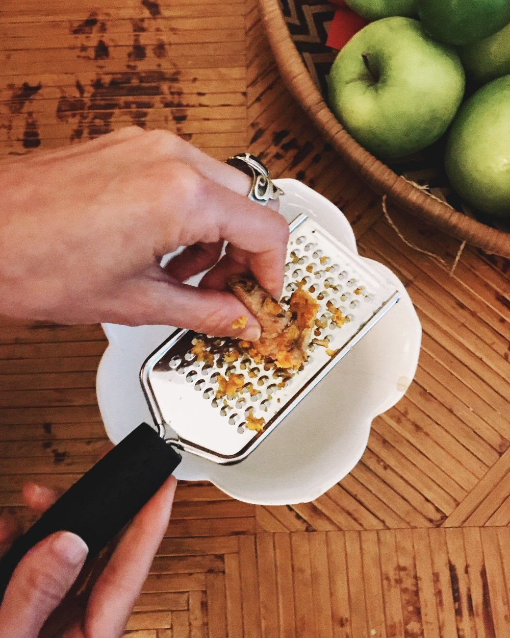 Grating the turmeric, your fingers will turn yellow, but that's how you know it's legit!