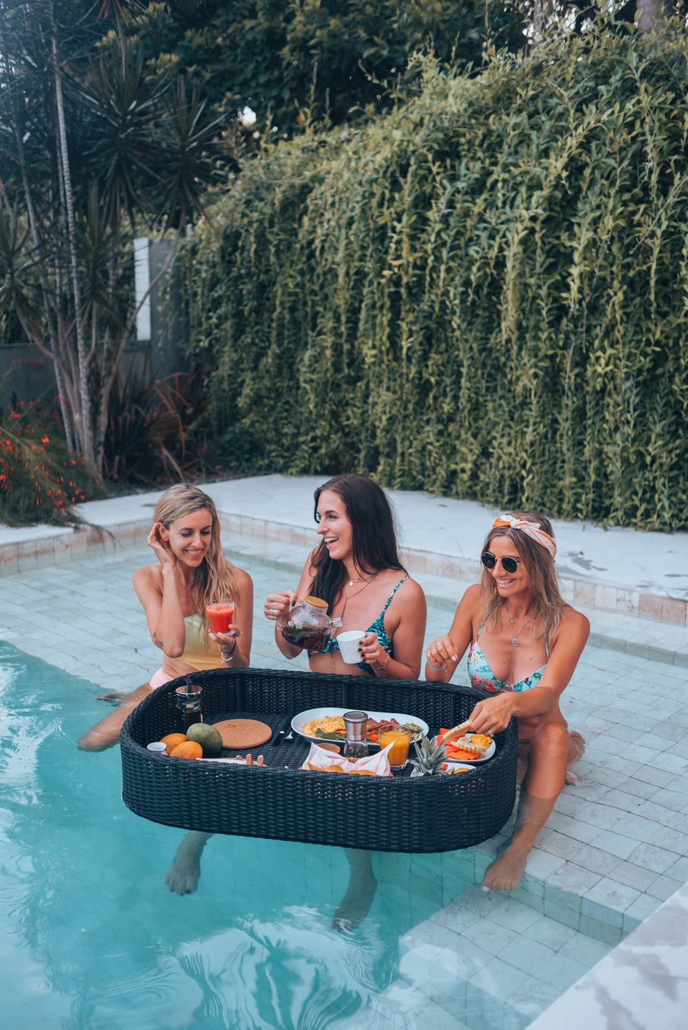 Floating breakfast bali vacation girls in the pool luxury travel experience