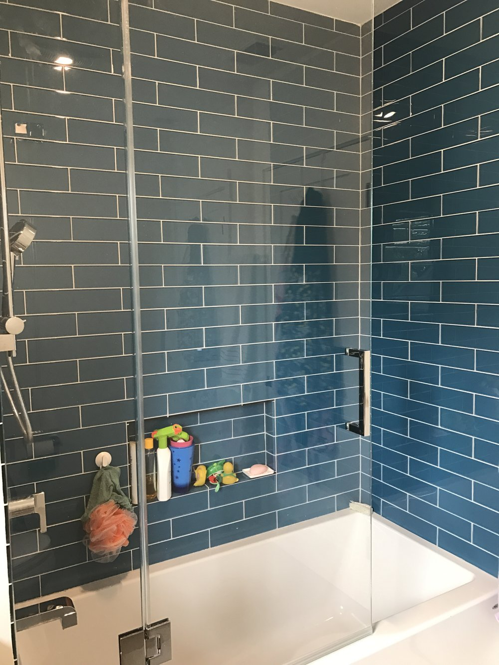 Blue glass tub surround — intelligent tile