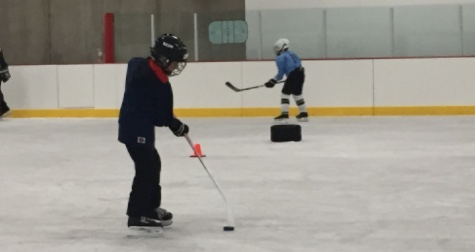 My son not knowing that he can't learn to play hockey.