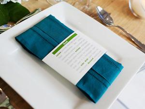 wedding menus wrapped around napkins