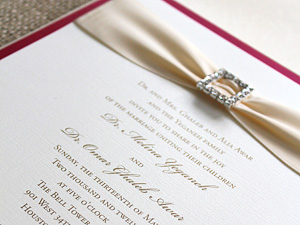 pink invitation with rhinestone buckle