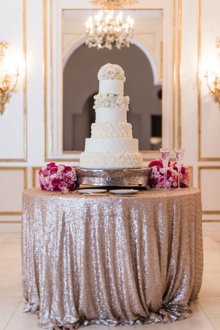 This amazing cake was made by Lisa Barcelona and we're obsessed with the sequin linens! Floral and decor: Flora and Eventi