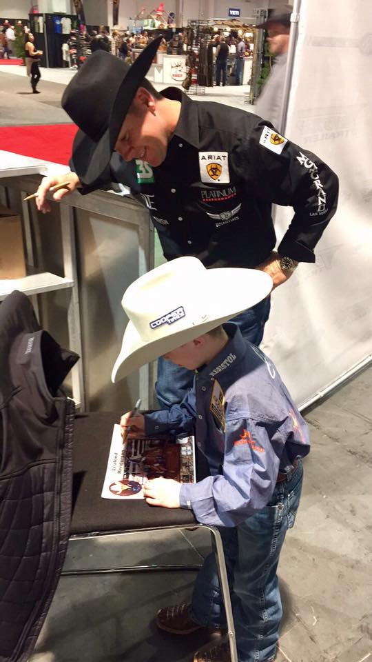 Trevor Brazile asked Leelan for his autograph.