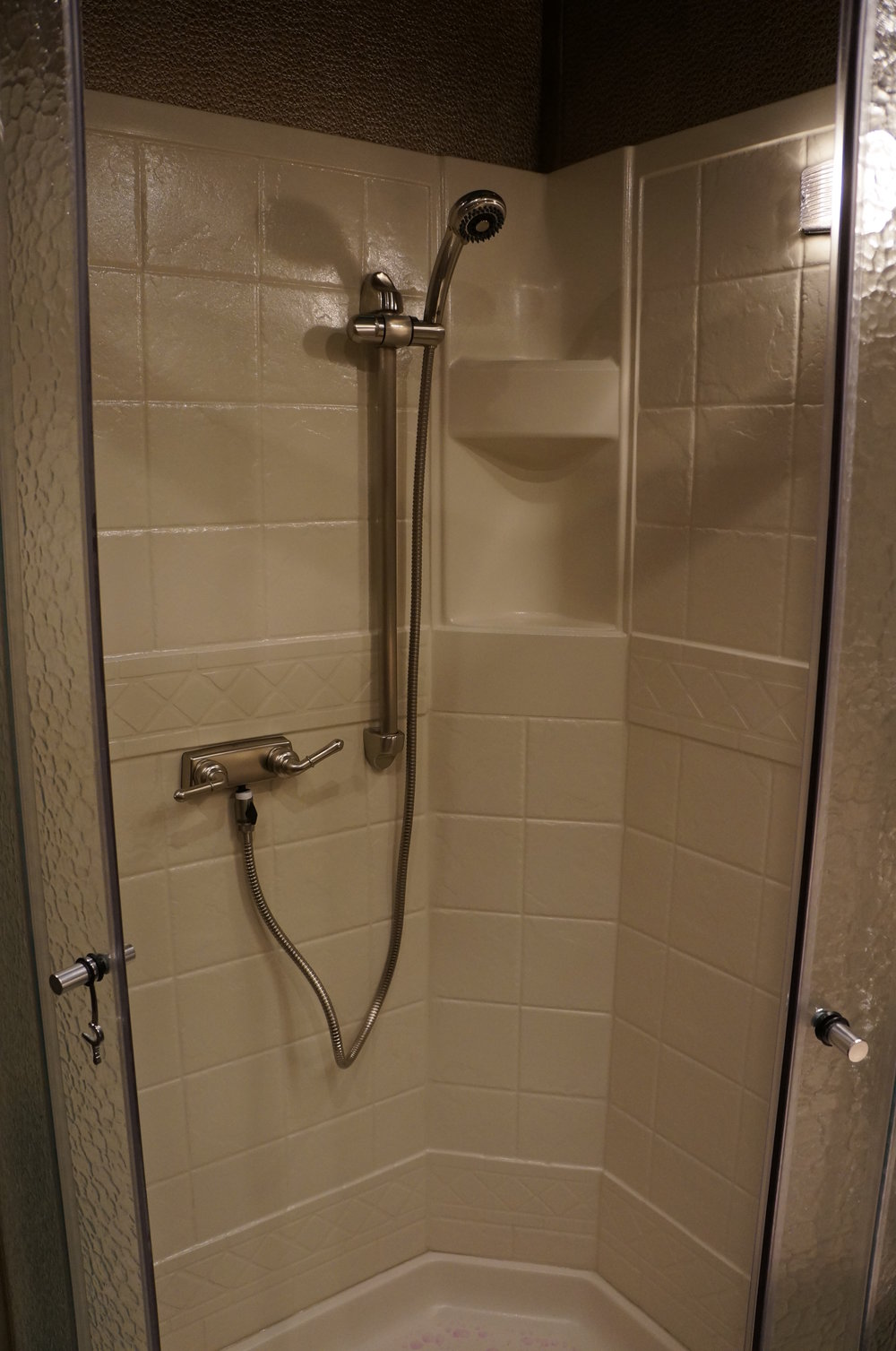 Almond Shower with Silver Faucet  & Shower Head on Slider Bar