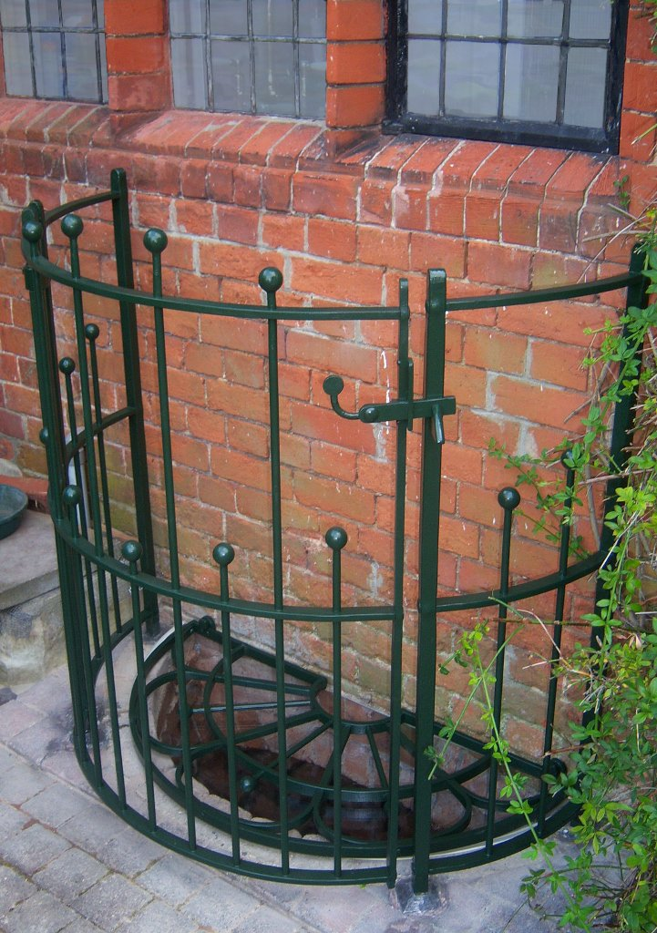 Curved railing and grate gate.