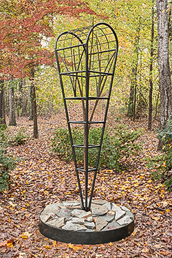 "W elded steel garden sculpture ""Heirloom Blight"" by artist Scott McCulloch in Greenville SC."