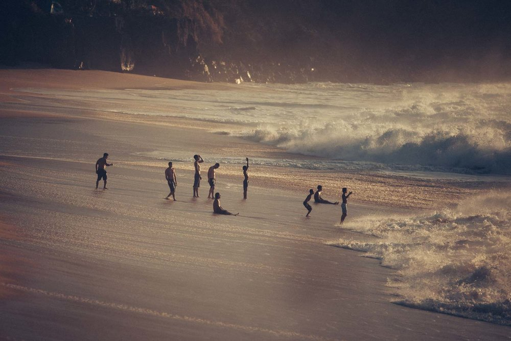 Amazing Hawaiian kids playing in the huge shore breaks.