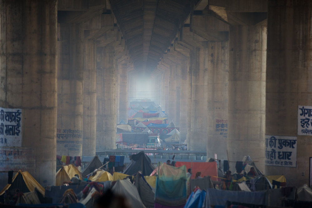 One of the most amazing sights was to find this temporary community, making home under the vast bridge that spans the site.