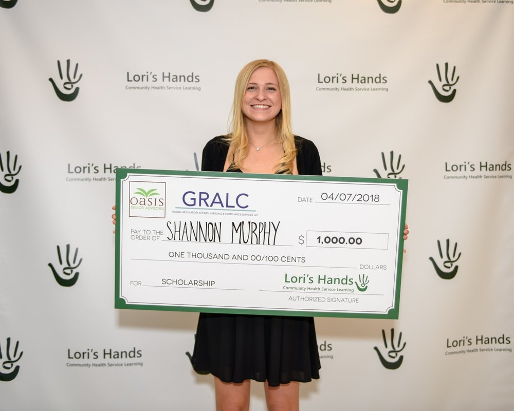 Shannon accepts her scholarship at the Green Ribbon Gala!