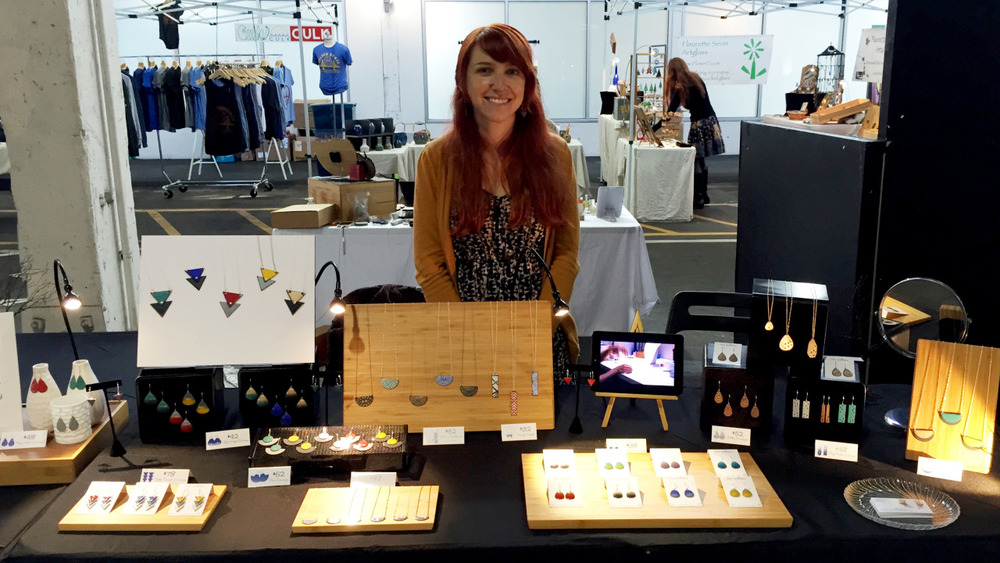 I had a blast last weekend at the   SF Etsy 2014 Indie Holiday Emporium   at  Pier 35 on the Embarcadero in the former SF Cruise Terminal. Despite the rain, there was a great turnout and it was fun to see some many local makers in one place. I was excited to show off my new table display featuring natural wood and an video by the talented       Ben Jungjareon    of me enameling in my studio to connect shoppers with my artistic process, which was a big hit.      If you missed me last weekend, I'll be at  San Francisco Bazaar  December 13th & 14th at Fort Mason. Or you can check out my  etsy shop  which I just updated with tons of new designs, just in time for the holidays!