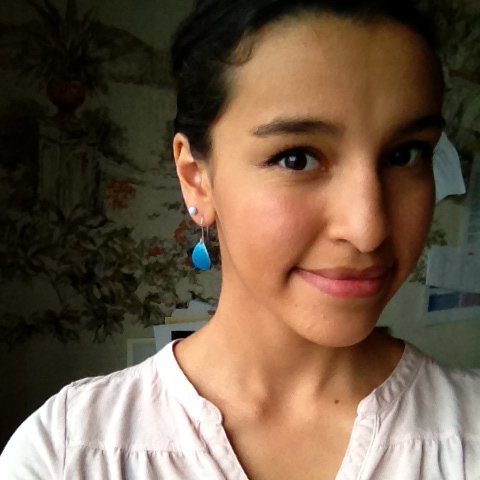 Tatiana in her tiny drop earrings.