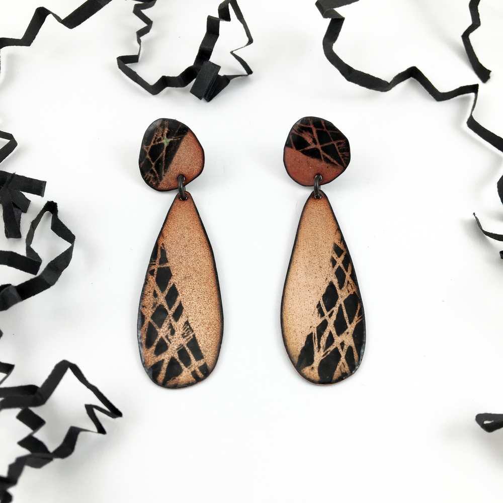 CrissCross Dangle Studs ($110)