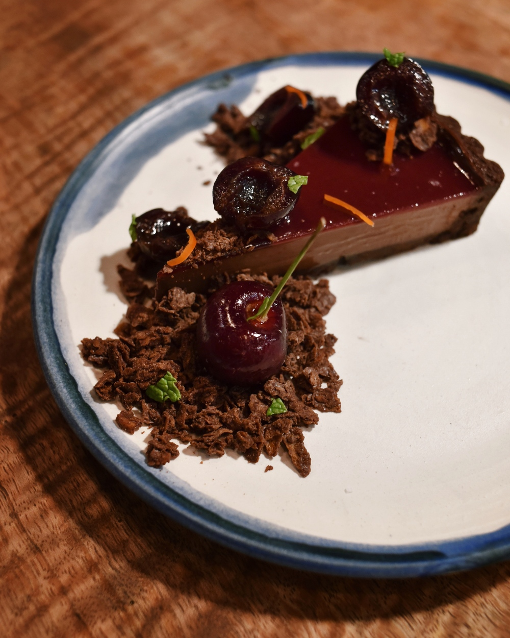 CHOCOLATE CHERRY OH BABY TART, valrhona dark chocolate cherry tart, compressed bing cherries in cacao and amaretto liqueur simple syrup, thai chili and chocolate salted feuilletine crunch