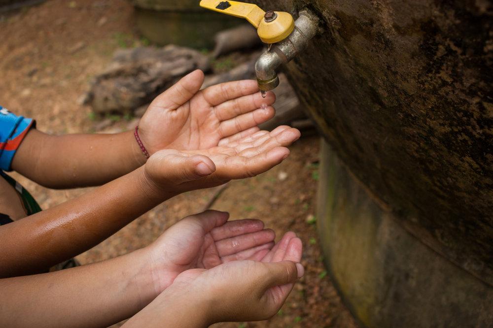 Childrenshandswaterdrop.jpg