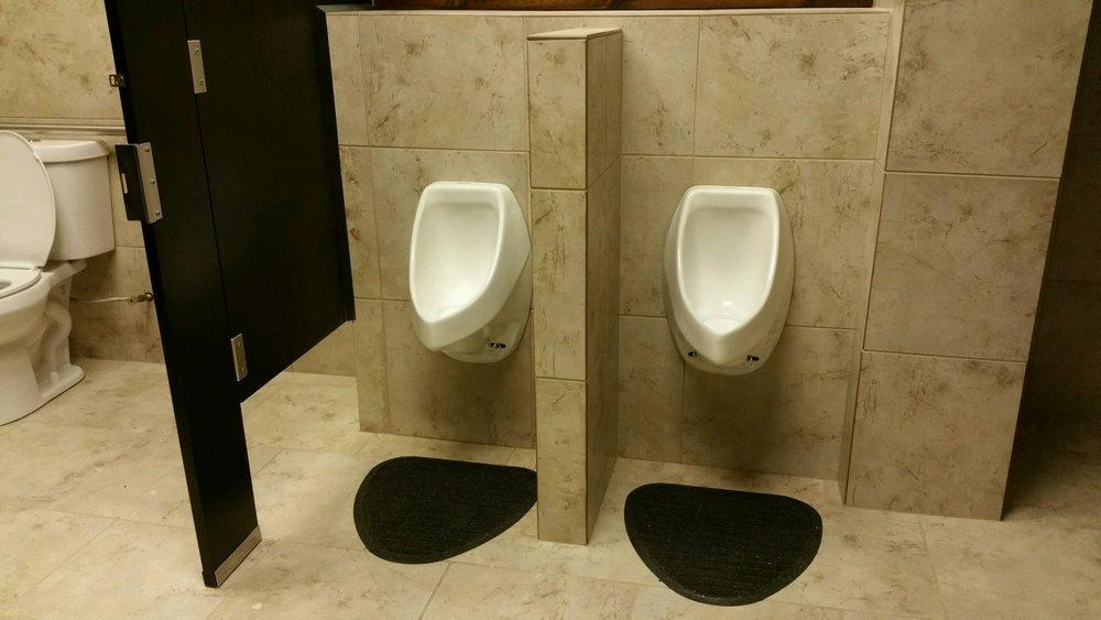 hotel restroom, waterless urinals in hotel