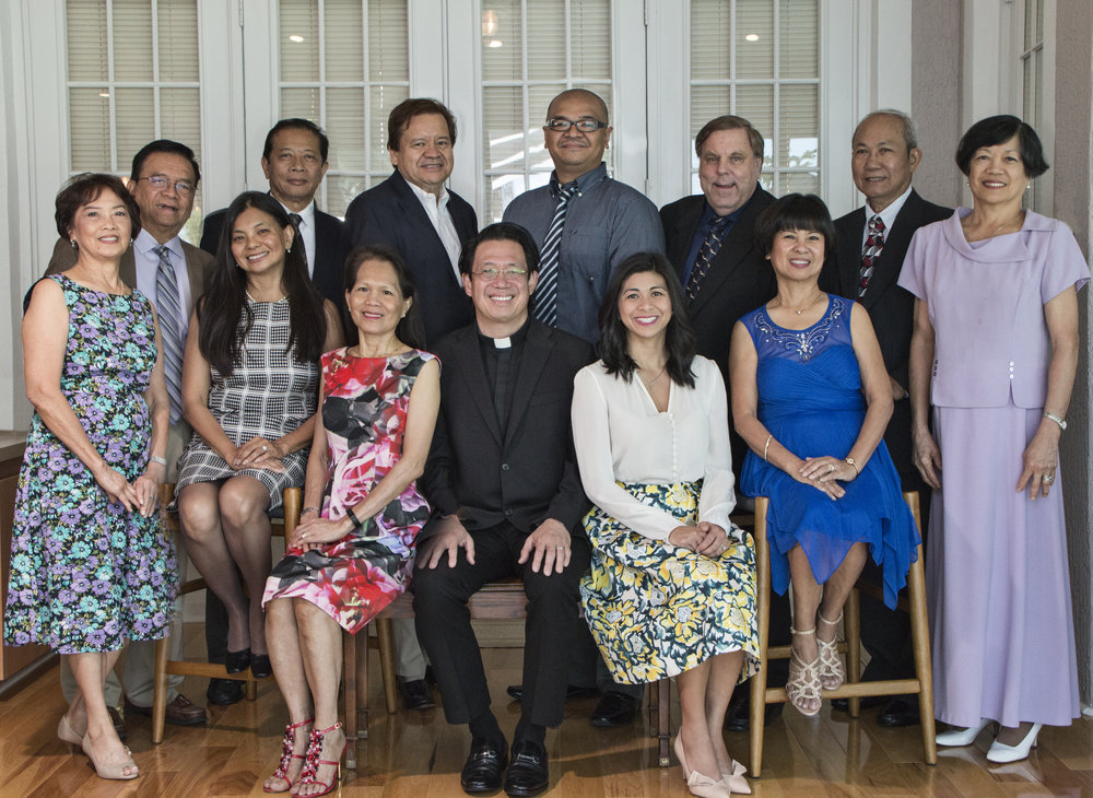 "Back Row (from Left to Right):  Tito Garcia (Chairperson), Dr. Patrick Gonzales (Chairperson), Whiteford Lewis, Glenn ""Jace"" Caparas, Ronald Marut, Frank Marquinez (Treasurer)     Front Row (from Left to Right):  Bella Garcia (Secretary), Liza Gonzales (Chairperson), Myrna Lewis, Father Kenny Aquino (Founder & Spiritual Director), Janice Pinuela, Tess Marut, Nitz Marquinez"