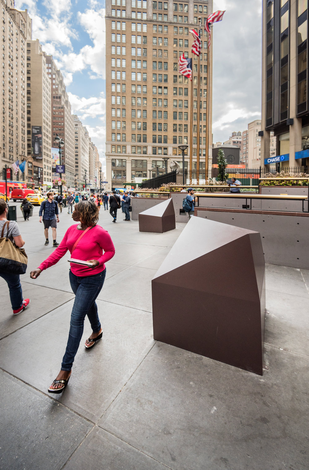 Bollards designed to  designed to be dynamic, prevent sitting on and add positively to the entry experience of the building and Penn Station, while limited vehicular access