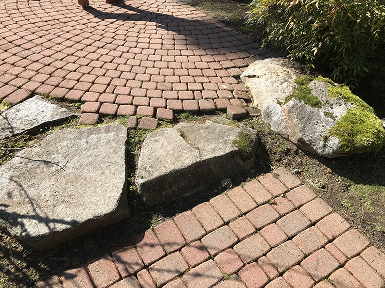 Poor planning and craftsmanship for paver edge on top.