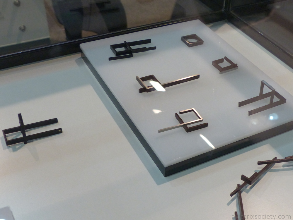Mexican jewelry designer Iker Ortiz at Zona Maco. Industrial multi finger square metal rings