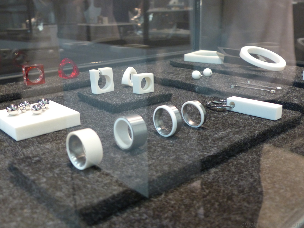 Mexican jewelry designer Iker Ortiz at Zona Maco. Industrial, tough, minimal white/silver red rings