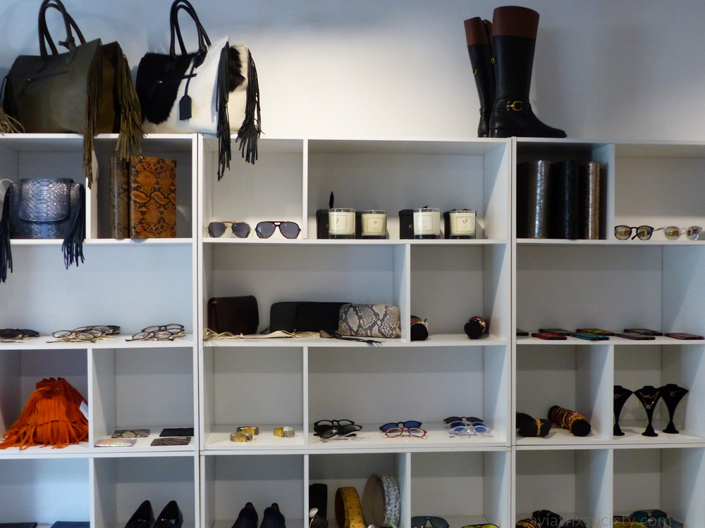 Accessories wall (boots, leather bags, candles, sunnies, clutches, at Cañamiel in Polanco DF part of our shopping guide of Mexico City