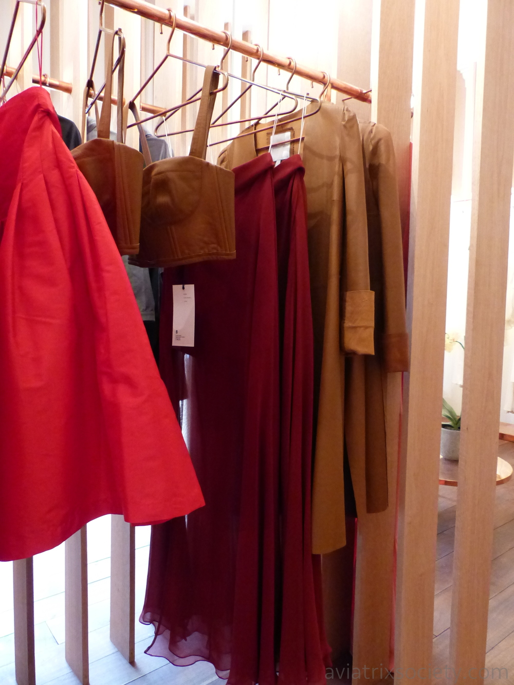 Full red skirts, tan leather bustiers, long leather jackets at Sandra Weil in Polanco Mexico City cdmx