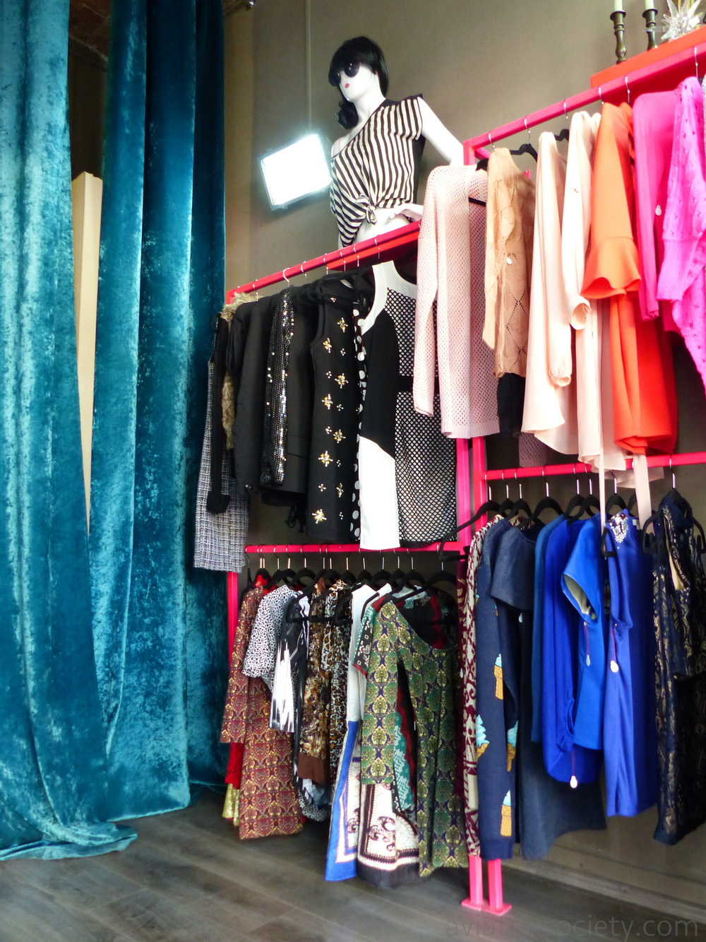 Feminine jewelry, dresses, tops, and skirts with bright colors and fun prints at the Sibling Boutique in Roma - part of our shopping guide for Mexico City