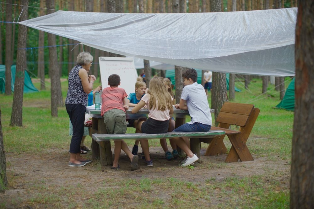 Bev teaching her class outside under one of the new rain shelters