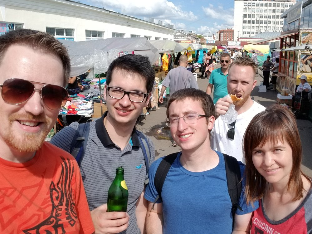 Pete, Adam, Nathan, Anya and Kenny enjoying street food at the market