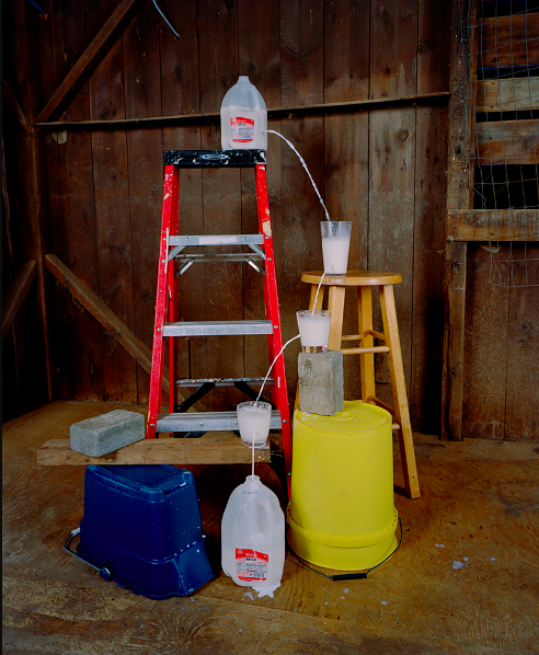 "Adam Ekberg , ""Transferring a gallon of milk from one container to another"", 2014, archival pigment print, 50 x 40 inches, Courtesy of the artist and ClampArt, New York City. From the show ""PASS / FAIL"" curated by  Will Hutnick  at OyG."
