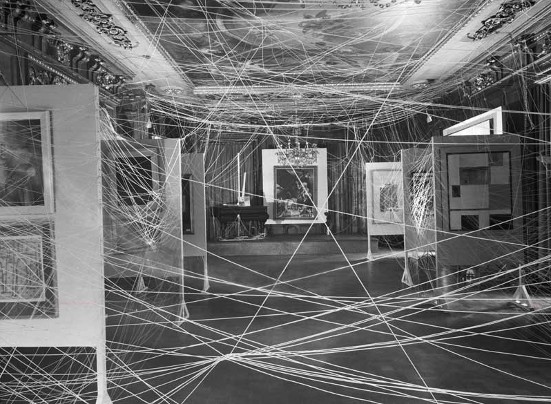 John D. Schiff,   Installation view of  First Papers of Surrealism  exhibition, showing Marcel Duchamp's  His Twine  1942,   Gelatin silver print.   Gift of Jacqueline, Paul and Peter Matisse in memory of their mother Alexina Duchamp.   Philadelphia Museum of Art