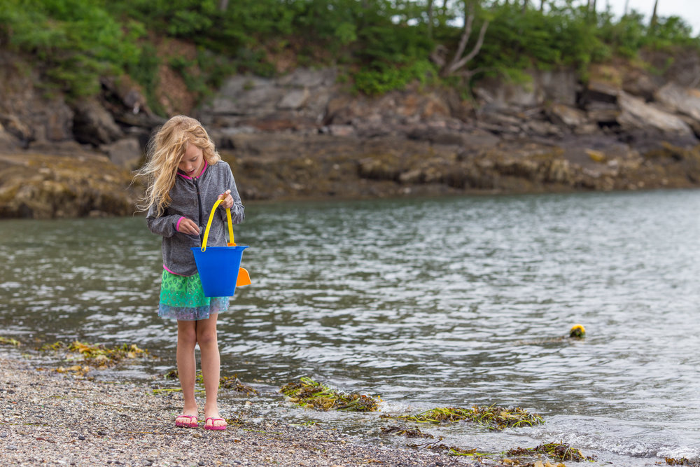 hunting for sea glass in Diamond Cove, Maine
