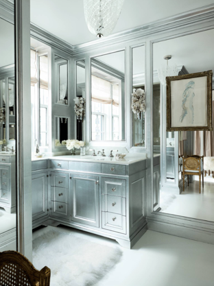 What a glamorous bathroom!!!! The custom cabinets have P.E. Guerin hardware—-always a spark of jewelry to any bath. The incredible sconces are from the 1920s. I love the use of the mirrors in all different sizes. This is my style of bathroom—- gorgeous!!!