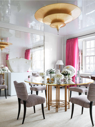 """The chandelier in the dining room is a tiered Fortuny pendant—— what a glorious focal point!!!! The mirrored and lacquered walls reflect all of the beautiful elements of the room. The dining table has a base from Patrice Dangel topped with a guilded edged piece of glass from Stephen Cavallo/Mirror Fair. Stunning!! The dining chairs are custom. This couple have spent their lives in """"high-flying careers in diplomatic and legal circles."""" Can you imagine the dinner parties that will take place in this room!!!!!"""