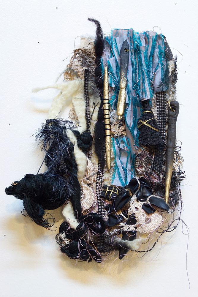 "blue yonder. 2016. wool, silk, latex, stoneware, handwoven cloth, thread, dye. 12""x 9""x 2.5"""