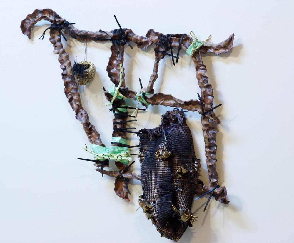 """smokrise moonbeam. 2015. stoneware, handwoven cloth, tape, zip ties, rope, found nest. 26""""x 25""""x 4"""""""