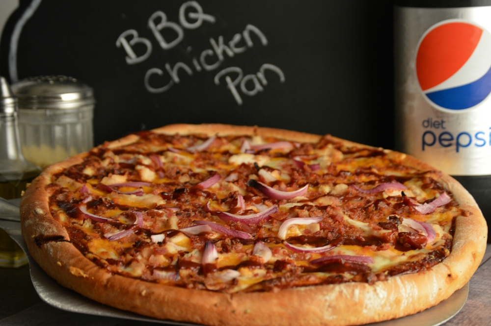 BBQ CHICKEN PAN: BBQ sauce, roasted chicken strips, bacon, onions, mozzarella and cheddar cheese.
