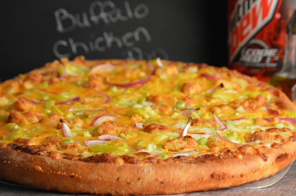 BUFFALO CHICKEN PAN: your choice of spicy pizza sauce, bleu cheese dressing and ranch dressing, romano, fontinella cheese, spicy chicken strips, hot peppers, onions, diced celery, topped with mozzarella and cheddar. (ONLY AVAILABLE IN PAN CRUST)